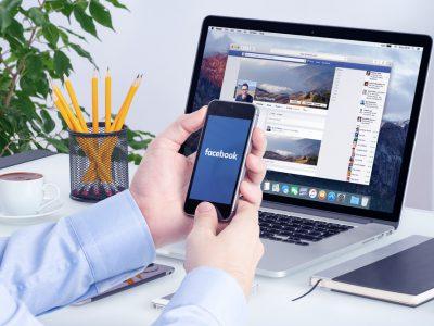 facebook workplace employee mobile laptop