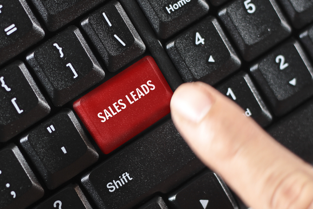 sales leads words on red keyboard button