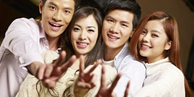 asian couples peace v sign