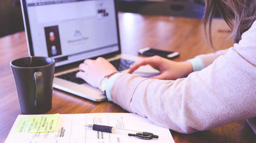 woman using laptop tech