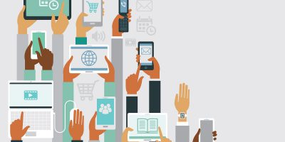 hands holding various smart devices