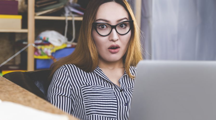 Portrait of surprised asian girl with laptop