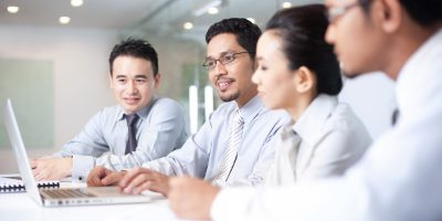 Four business professionals with laptop