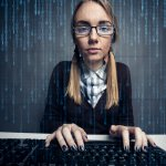 Woman at computer with code