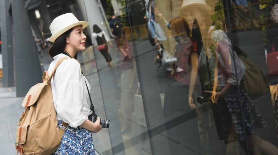 woman window shopping in Hong kong