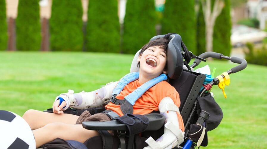 a disabled boy in a wheelchair