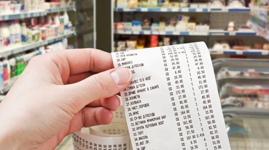 a person checking their receipts at the supermarket