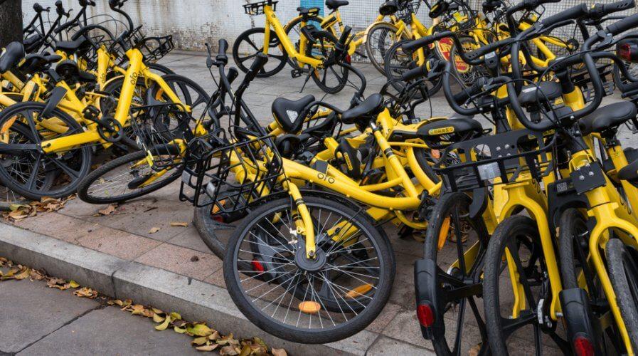 sharing bikes abandoned on the sidewalk