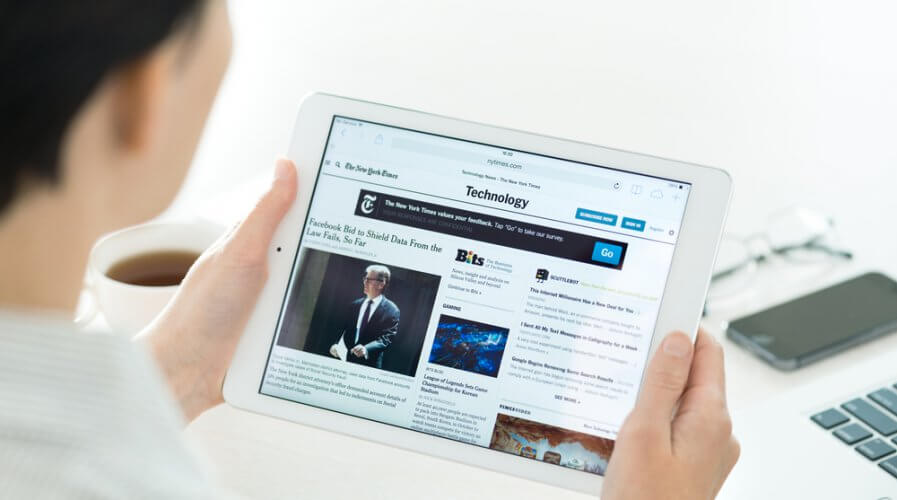 a man reading an online news site