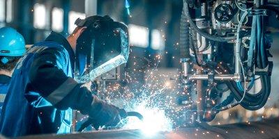 a worker welding in a factory