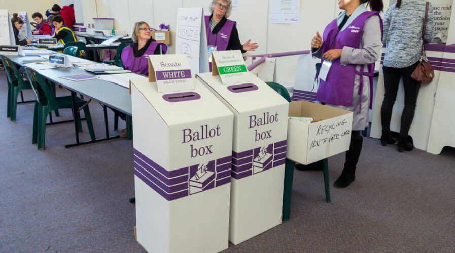 officials at a polling place in australia