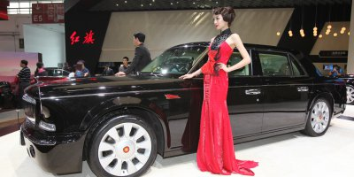 """(FIle) Models pose with a Hongqi L5 car on display at the China International Exhibition Center new venue during the """"Auto China 2014"""" Beijing International Automotive Exhibition in Beijing on April 20, 2014. Source: AFP"""
