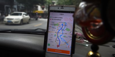 China's largest ride-hailing services provider recently launched a web of financial services integrated to its app to boost profit. Source: GREG BAKER / AFP