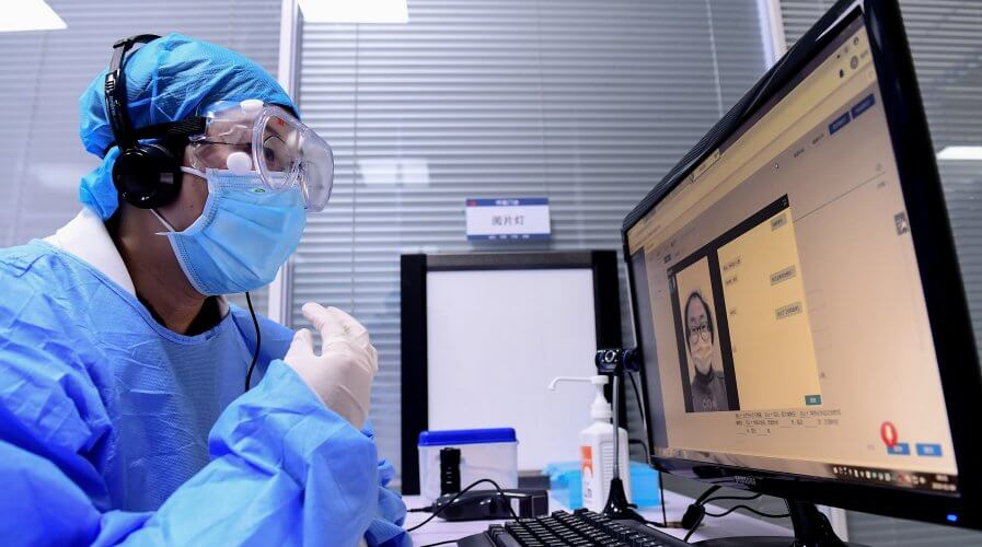 A doctor is attending to patients online through telemedicine app. Source: AFP