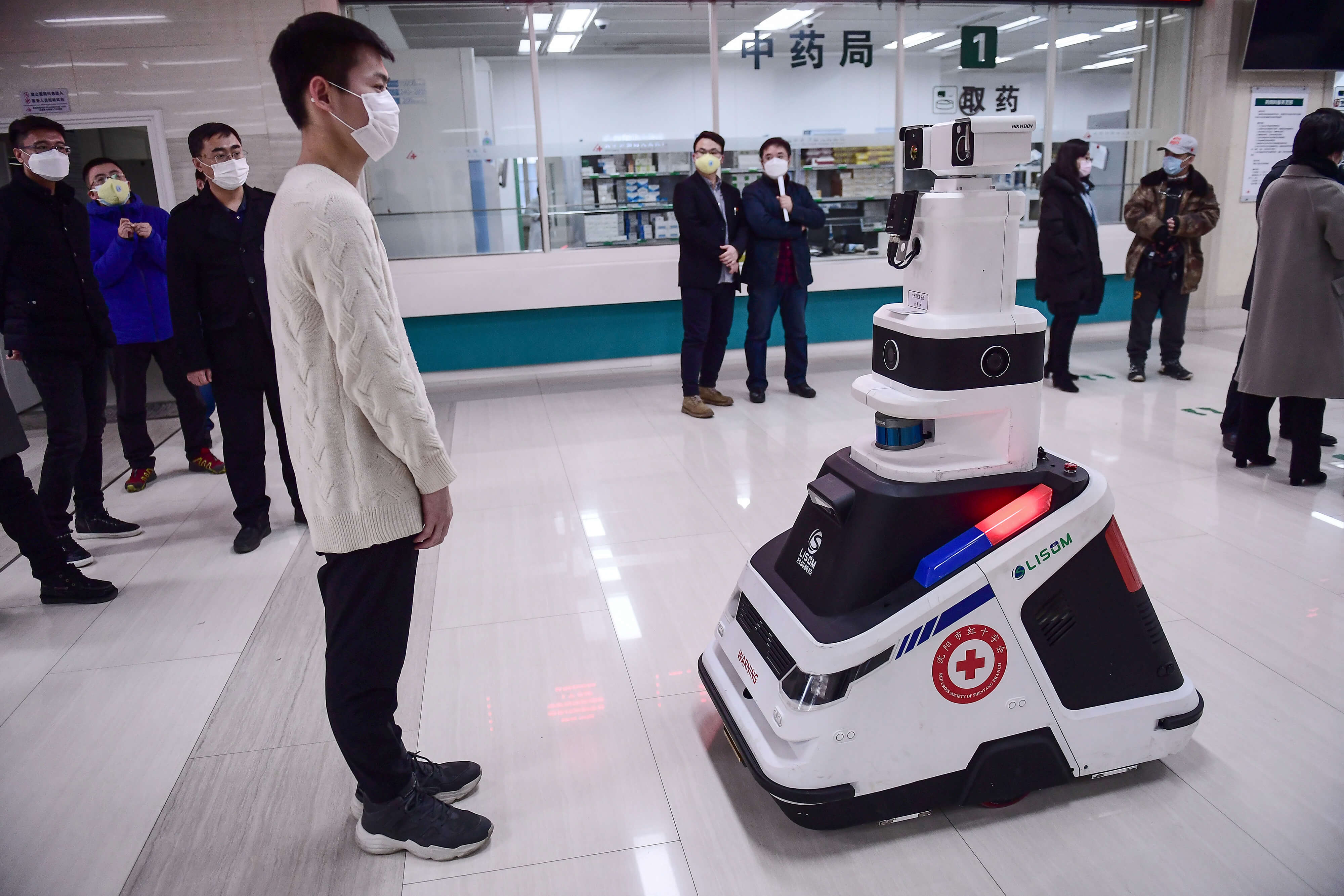 A patrol robot used to check temperatures, identities and disinfect people in Shenyang in China. The hospital uses the robot to reduce the pressure on front-line medical staff.