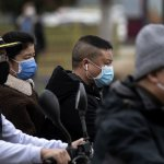 Chinese motorists with face masks in Jiujiang. Source: AFP.