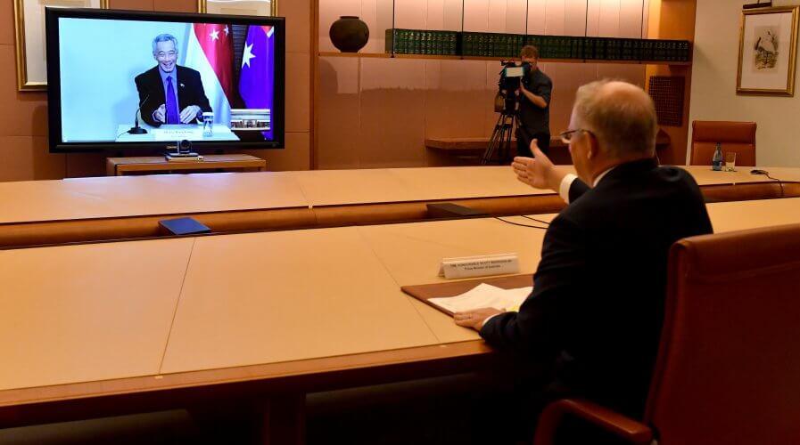 Singapore's Prime Minister Lee Hsien Loong giving Australia's Prime Minister Scott Morrison a virtual handshake. Source: AFP.