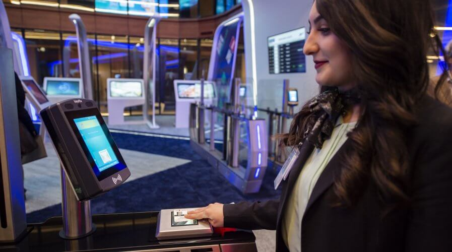 "An attendant does the test of facial recognition using biometry technology in the ""innovation hub"" of Istanbul airport. Source: AFP"