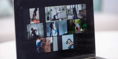 A Hong Kong yoga teacher leading a live streamed yoga class on the Zoom online video conferencing platform.