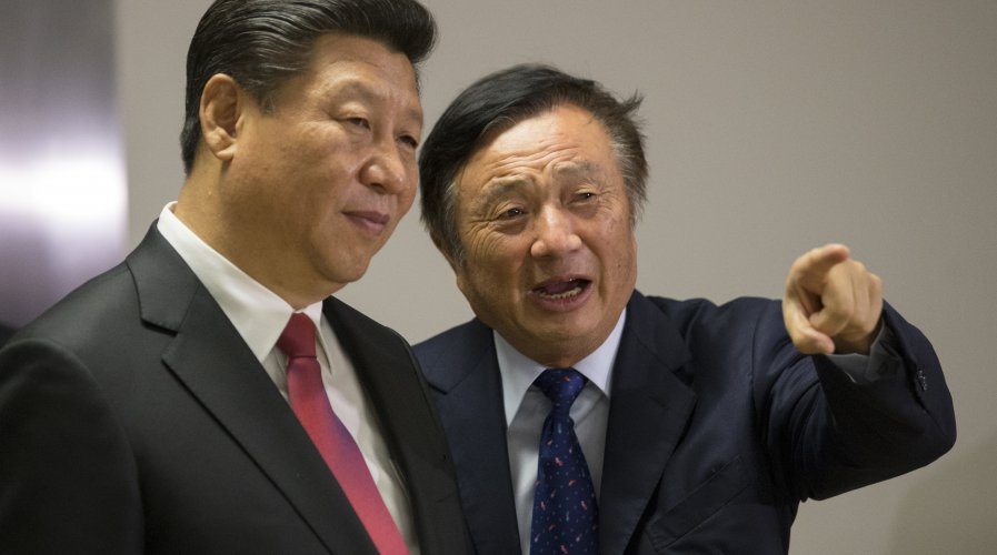 Chinese President Xi Jinping (L) is shown around the offices of Huawei by its President Ren Zhengfei. Source: AFP