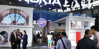 People gathering at a Nokia booth during the Mobile World Conference in Shanghai.