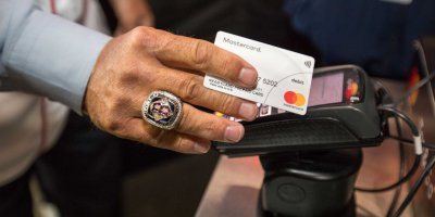 A Mastercard contactless terminal being used at the baseball World Series.