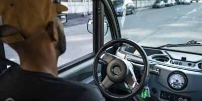 An Optimus Ride autonomous vehicle as it drives through the Brooklyn Navy Yard.