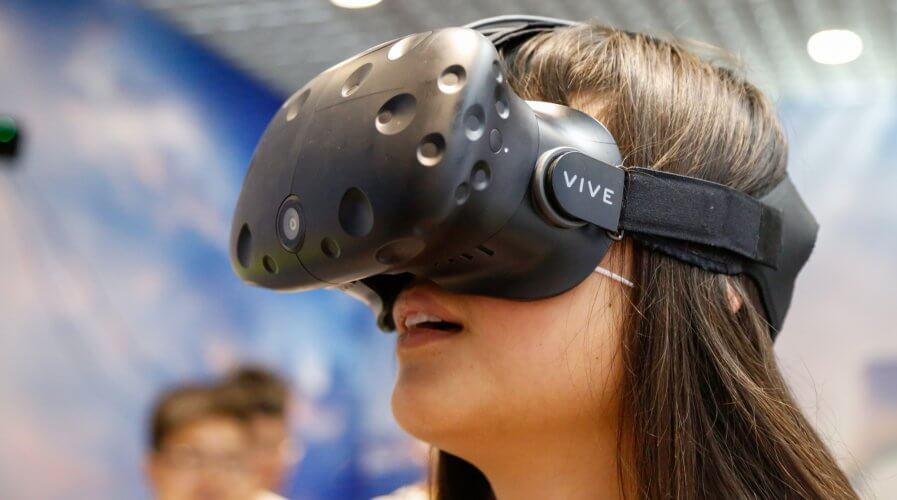 An HTC Vive mixed reality headset in action.