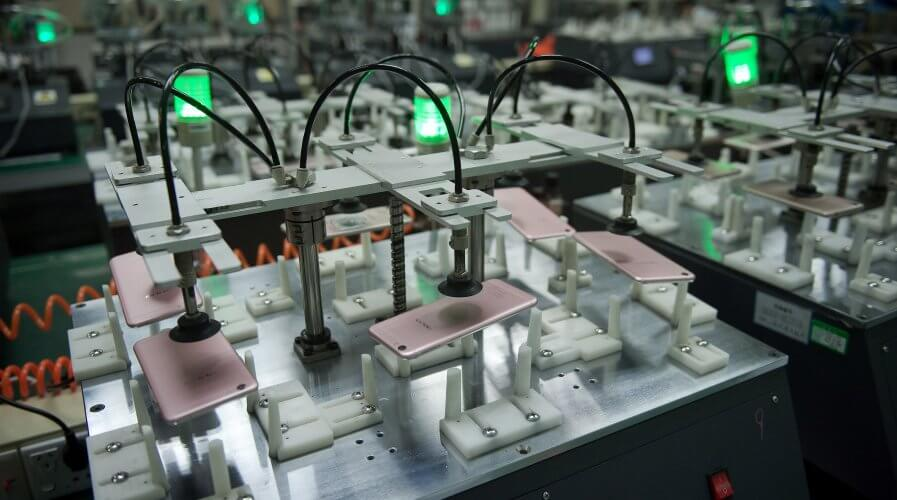smartphone products are dropped at the testing facility of the Oppo factory in Dongguan