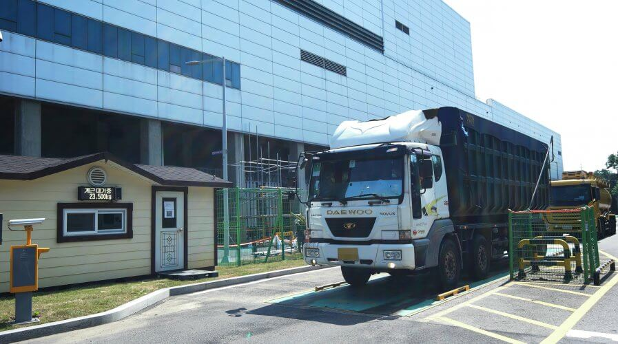 A supply truck departs Samsung's semiconductor factory