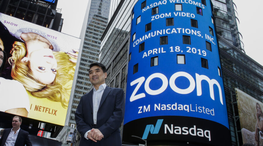 Zoom founder Eric Yuan poses in front of the Nasdaq building after the opening bell ceremony on April 18, 2019