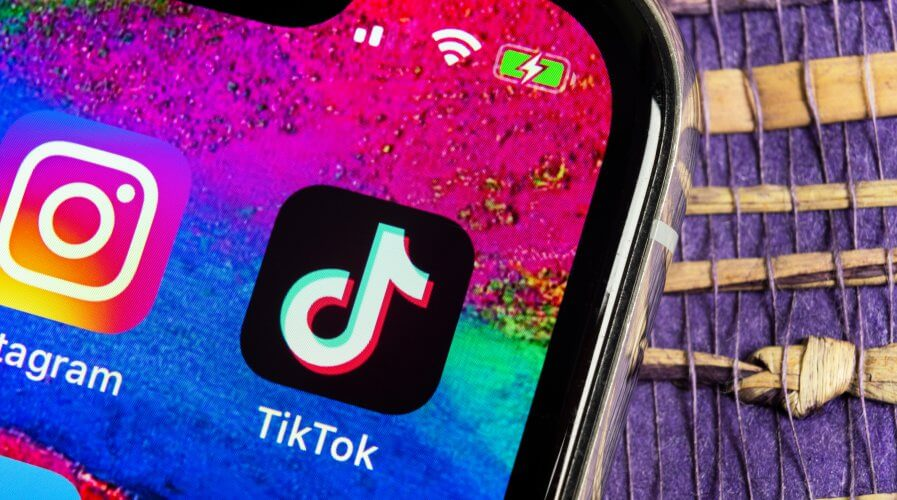 TikTok application icon on Apple iPhone X screen