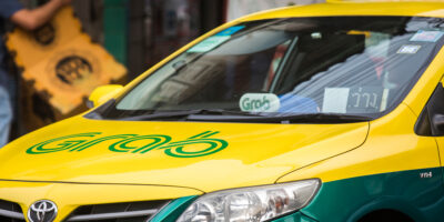 Grab branded taxi cab on the street of Bangkok