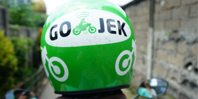 Driver wearing Helmet with Gojek Logo. Gojek is Indonesian transportation startup