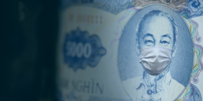 Five thousand Vietnam dong bill with a medical face mask on leader. Business concept. Selective focus.