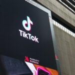 TikTok logo on a big screen. TikTok/Douyin is a Chinese video-sharing social networking service owned by ByteDance, a Beijing-based Internet technology company.
