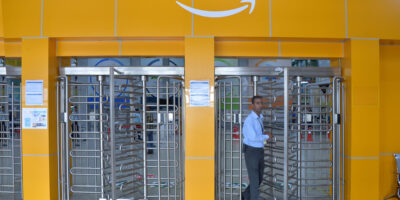 Employee of Amazon India walks out of a security gate at Amazon's fulfilment center on the outskirts of Bangalore.