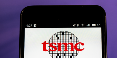 TSMC logo seen displayed on smart phone. Taiwan Semiconductor Manufacturing Company, Limited is world's largest dedicated independent (pure-play) semiconductor foundry