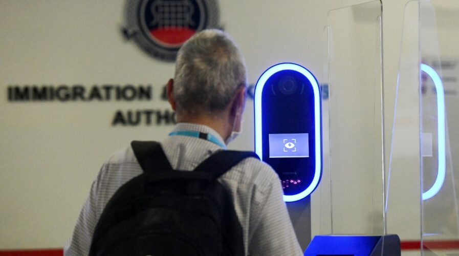 A passenger go through iris and face biometric scan tech replacing fingerprint machines at the ICA Marina Bay Cruise Centre in Singapore