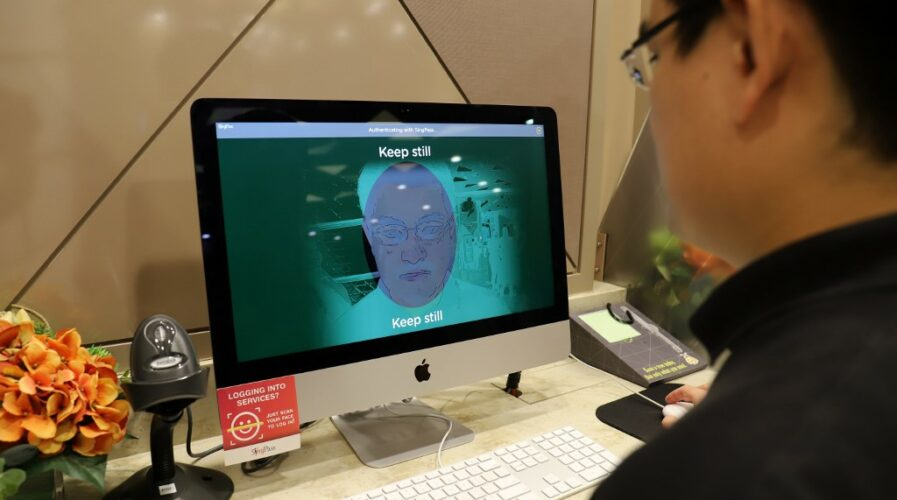 GovTech demonstrating the biometric facial verification tech to access government services, part of its digital government initiatives.