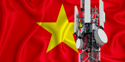 Vietnam flag, background with space for your logo - industrial 3D illustration. 5G smart mobile phone radio network antenna base station on the telecommunications mast emitting signal. 3D-rendering