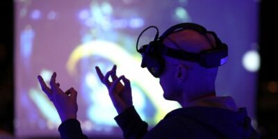 Virtual Production offers applications across multiple industries. Here, an attendee tries out augmented reality glasses at the AWE Expo Santa Clara. (Photo by JUSTIN SULLIVAN / GETTY IMAGES NORTH AMERICA / Getty Images via AFP)