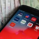 The APAC region has seen a massive jump in downloads of fintech apps, showing strong support for fintech to grow in the region. (Photo by Roslan RAHMAN / AFP)
