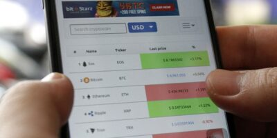 Tiger Brokers skip China for crypto services amidst crackdown by govt. Person looks at crypto trading prices on a mobile app