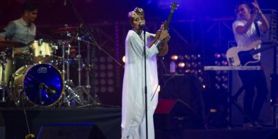 Blockchain could turn the tide for the media and entertainment industry and benefit content creators. (Pictured: Yuna performing on stage at the MTV World Stage Live in Malaysia 2014) (Photo by MOHD RASFAN / AFP)