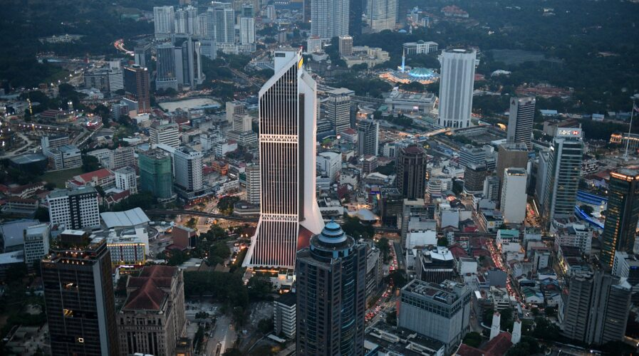 Consumers can't wait for digital banking in Malaysia to take off (Photo by Mohd RASFAN / AFP)