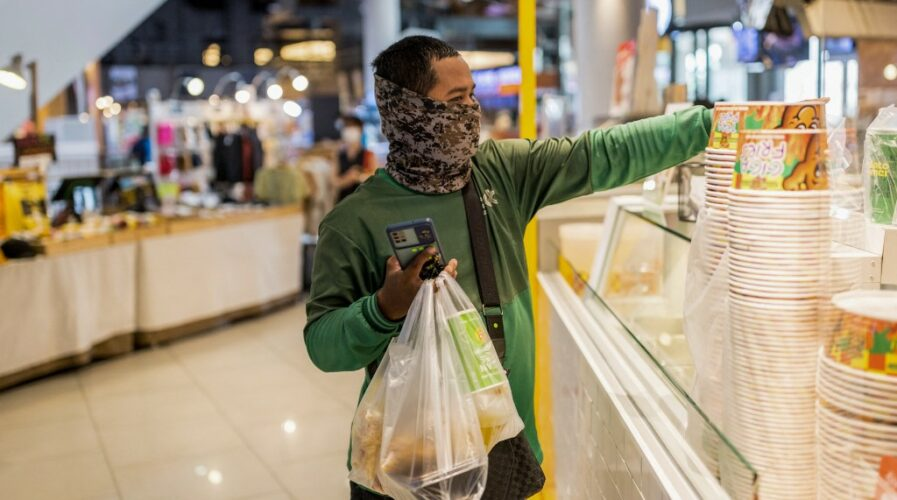 Digital trust in businesses are predicated on multiple factors, most notably service reliability, at least, in Asia. (Photo by Jack TAYLOR / AFP)