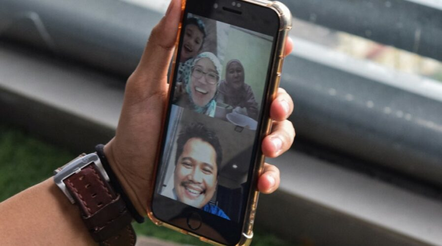 Malaysia's 5G network deployment will benefit industries and consumers, especially those who rely on tools such as video calls or conferencing. (Photo by Sam Reeves / AFP)