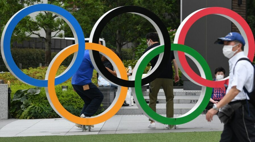 The Olympic rings are displayed near the National Stadium for the Tokyo Olympics. (Photo by Kazuhiro NOGI / AFP)