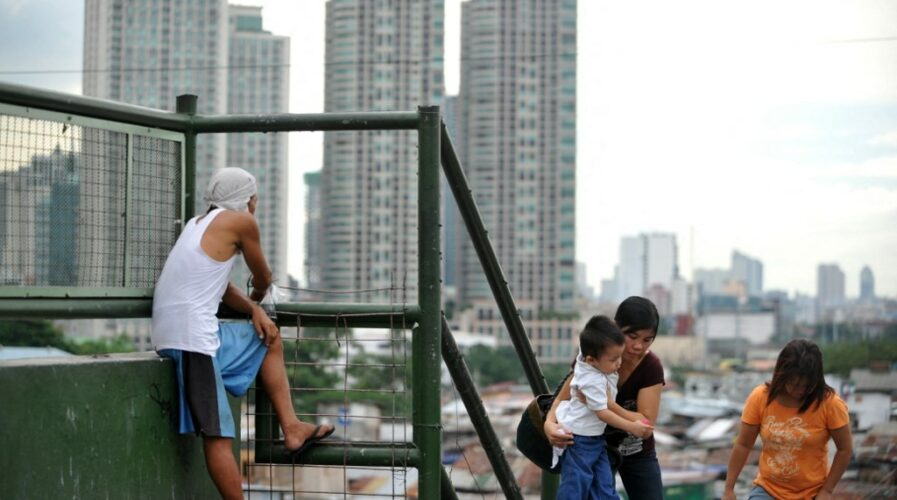 The privileged-underprivileged divide is prominent in certain parts of the Philippines. A large number of unbanked consumers reside here, and digital banking can help support and tap into this market. (Photo by NOEL CELIS / AFP)